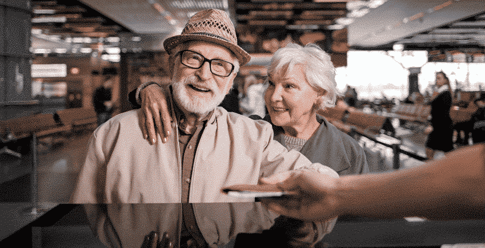 Holiday Ideas & Destinations For Older Couples: Old couple at airport