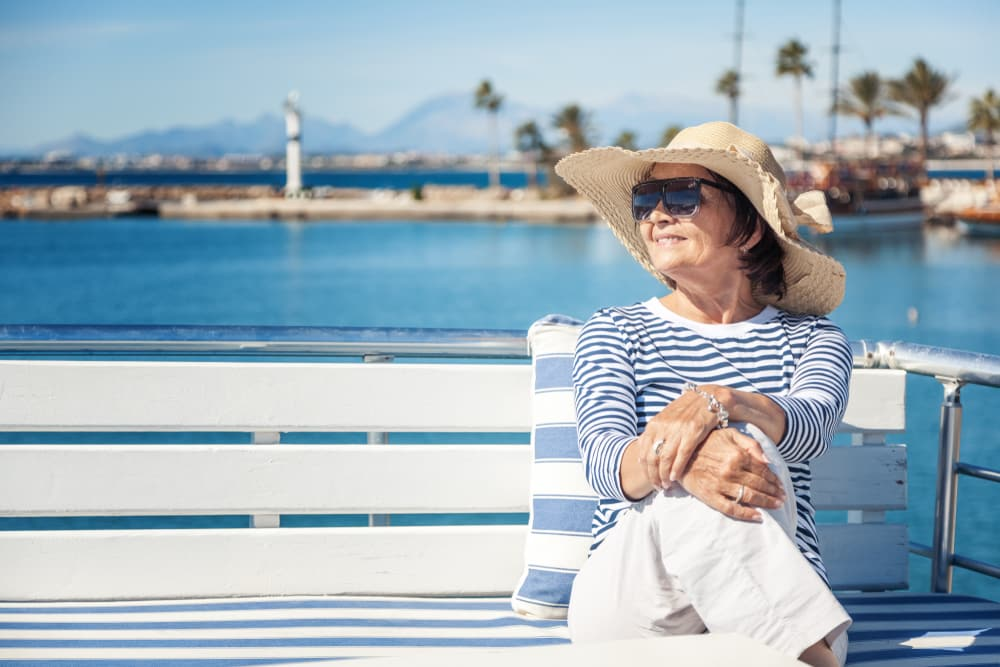 Over 60 Singles Holiday Ideas & Inspiration: Senior woman on holiday by the sea