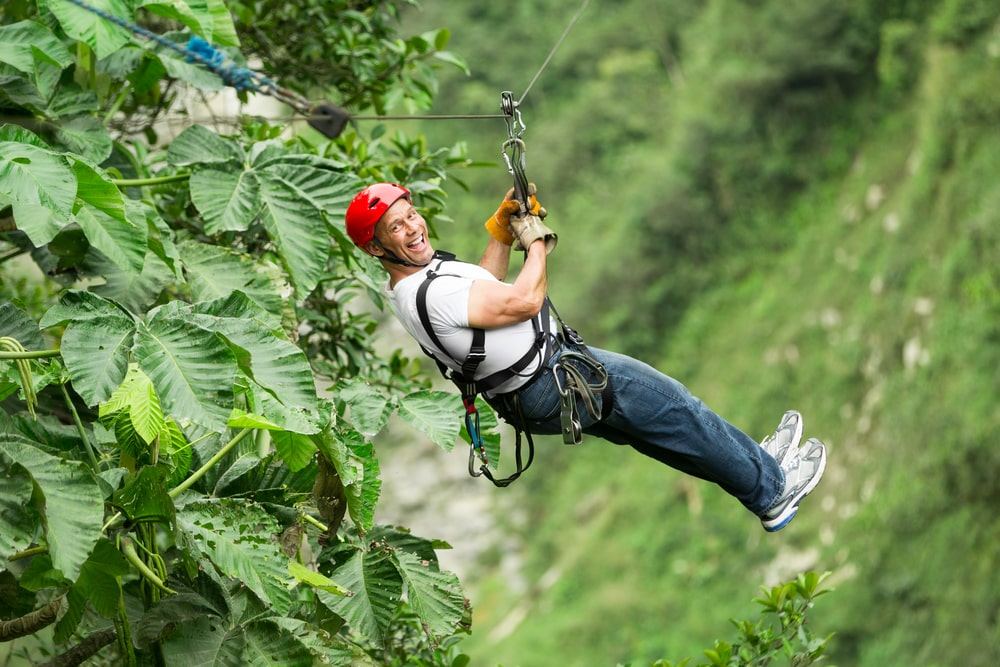 The 5 best ecotourism holidays for mature travellers: Mature man on zip wire