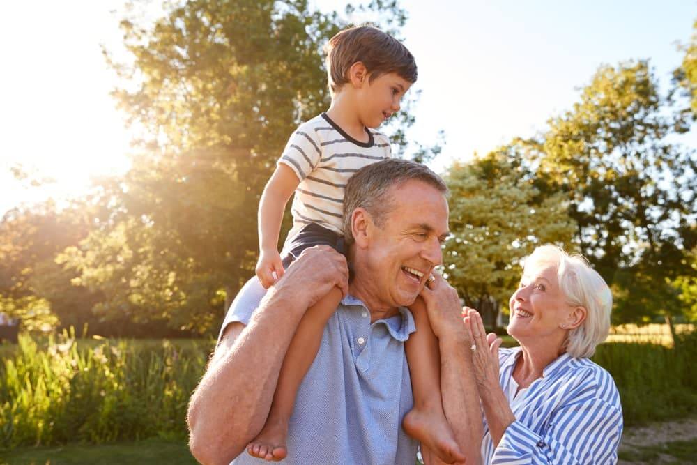 New Group to Support Access to Travel Insurance for Vulnerable Customers: grandparents on holiday with child playing in forest