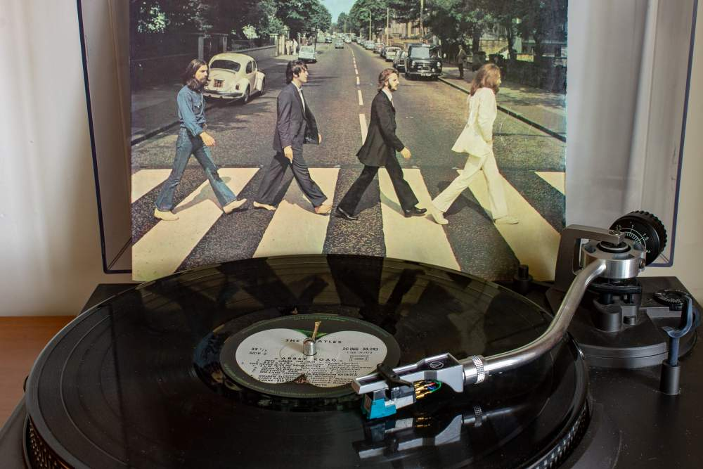 Celebrating the 50th Anniversary of The Beatle's Abbey Road Album: The album Abbey Road playing on vinyl next to the cover