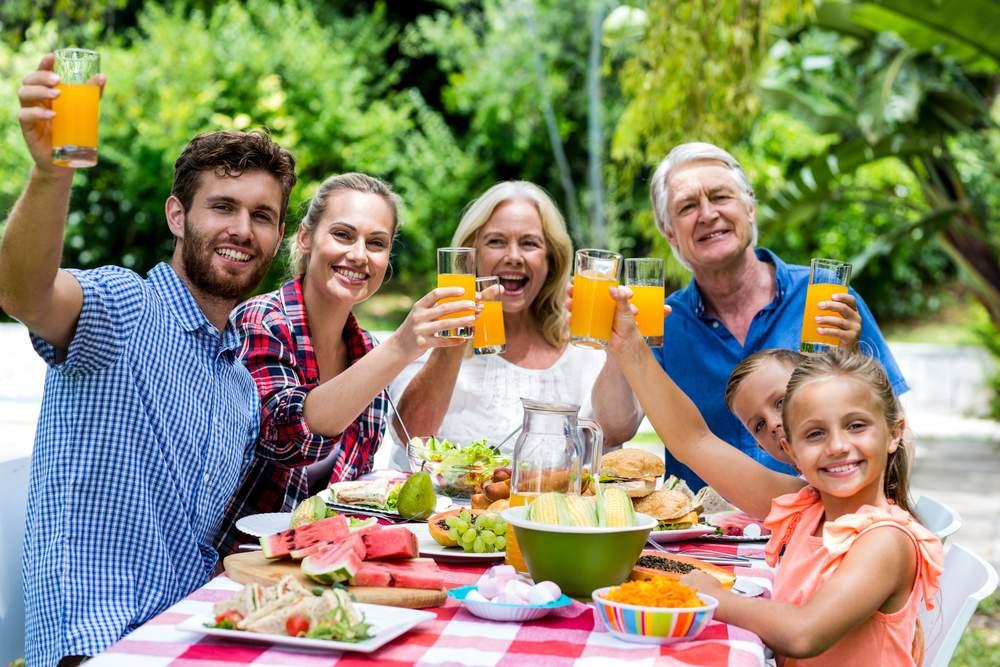 Organic September: multi generational family having outside meal