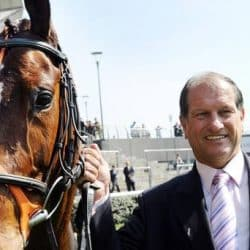 How Bob Champion overcame life's hurdles with AllClear Travel Insurance; Bob Champion guiding horse at race