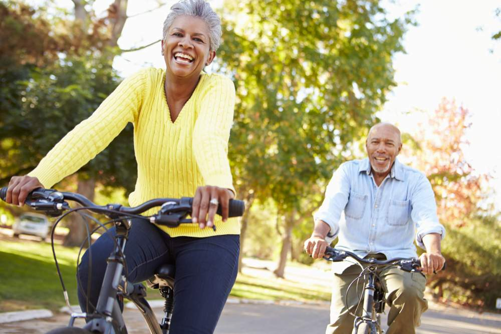 Know your numbers week 2019: Mature couple cycling in park