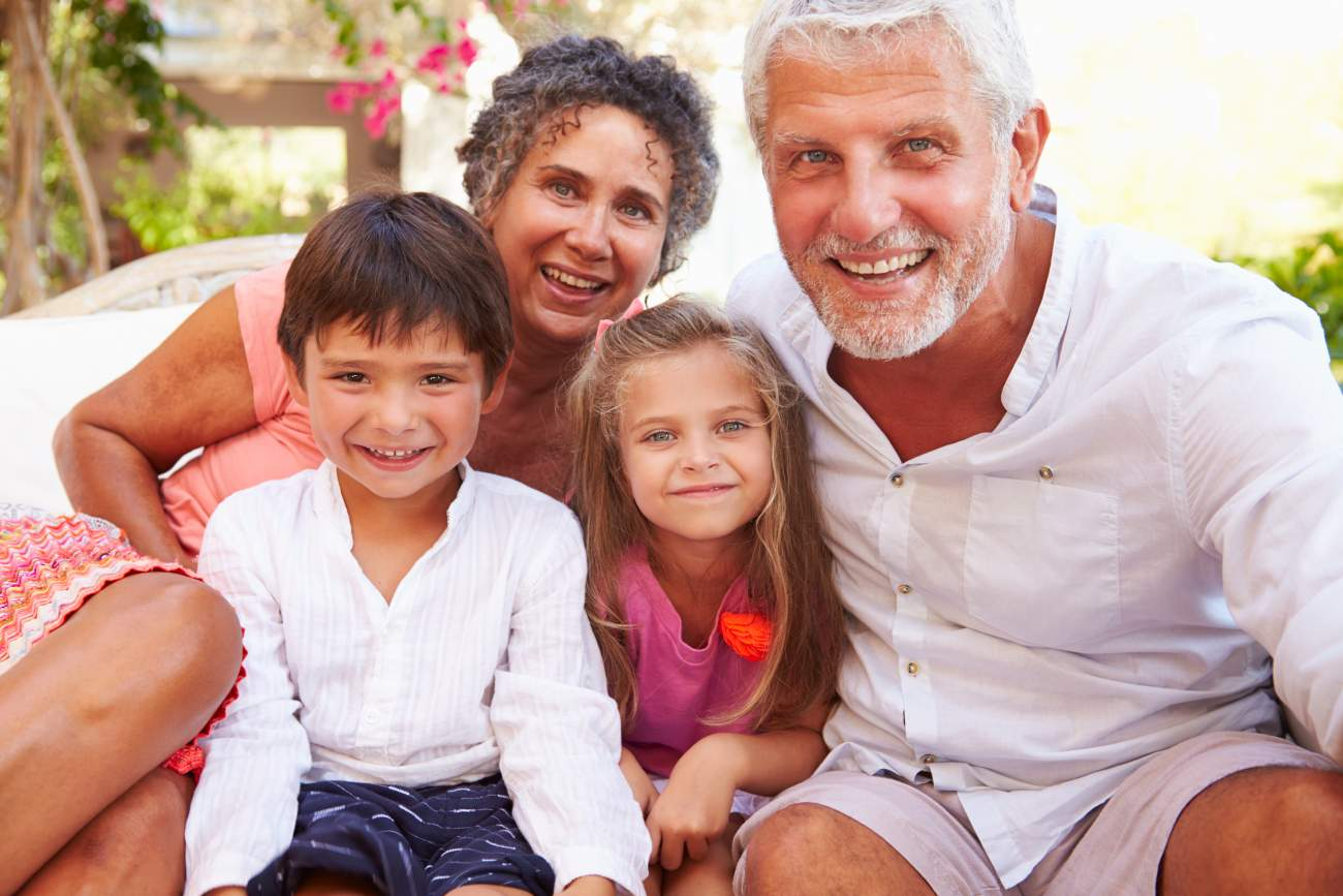 Tips for Travelling with Grandchildren: grandparents taking selfie with grandchildren on holiday