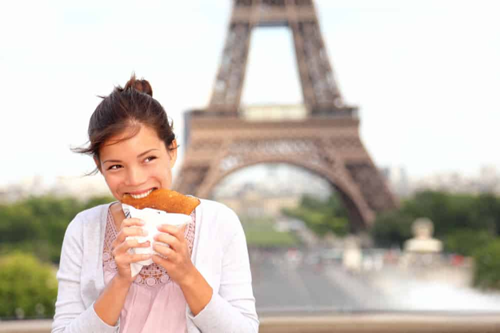 woman enjoying a pancake in Paris