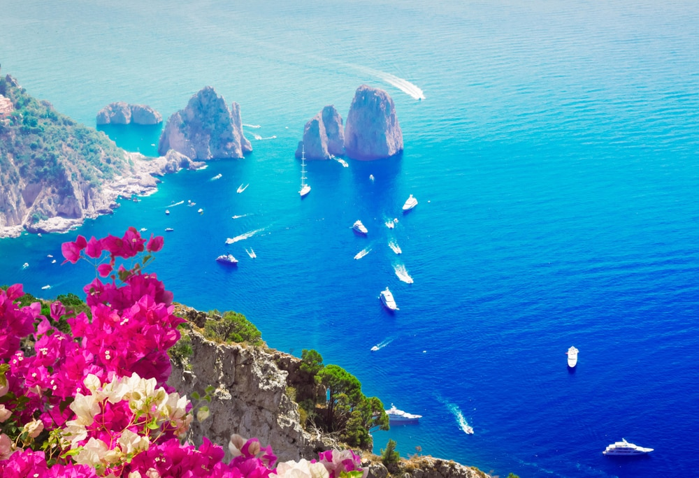 Top 5 travel destinations for spring 2019: Faraglioni cliffs and Tyrrhenian Sea, Capri island, Italy