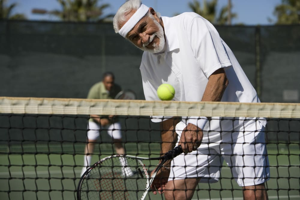 How to get fit when you are over 50 | Be inspired by this summer of sport: Senior man playing tennis