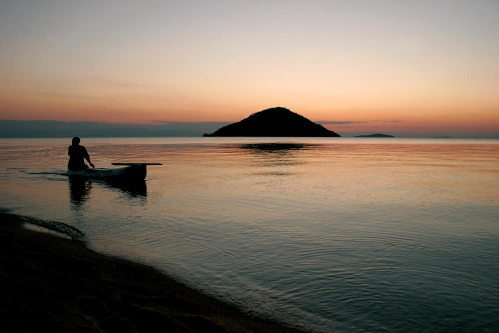 The best Autumn holiday destinations: Main on boat in Malawi