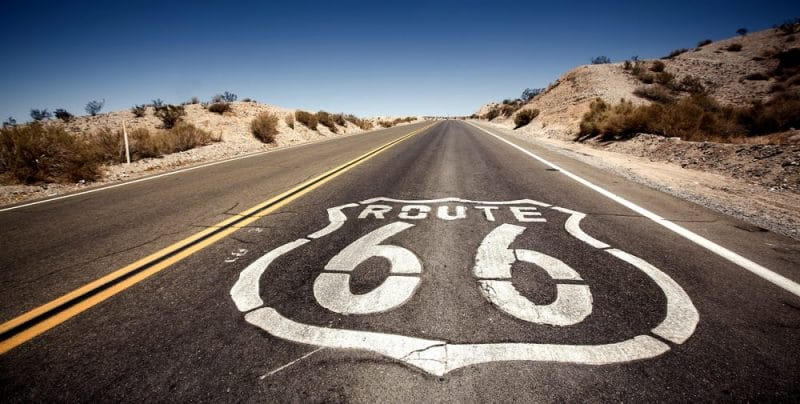 A sign for route 66 following single trip travel insurance to America