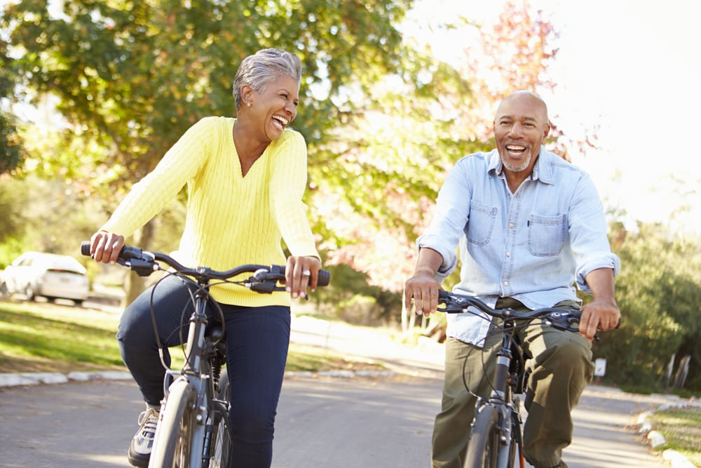 Travelling with a mental health condition: Mature couple cycling in park