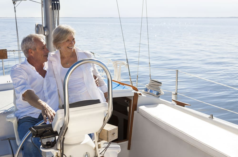 Unconventional travel ideas for all the family in 2019: Mature couple sailing in the atlantic ocean