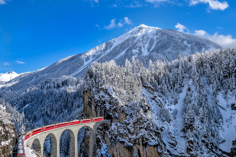 Solo Travelling Over 60 - Singles Holiday Ideas / Inspiration: A train in the snowy mountains