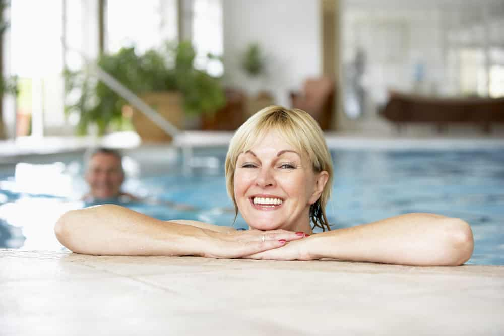 How to get fit when you are over 50: middle age woman swimming