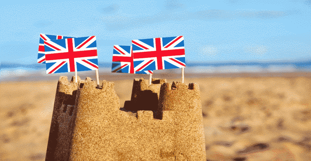 10 things that make a great British holiday: sand castle with British flag