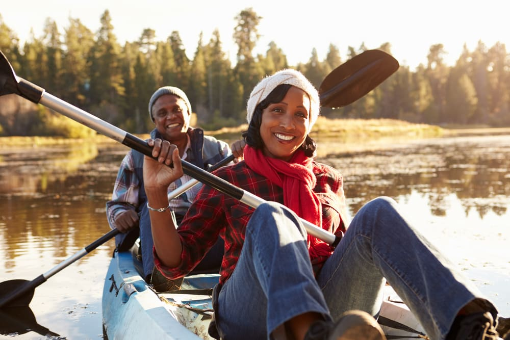 Travel Vaccinations Guide: Mature couple kayaking in sun