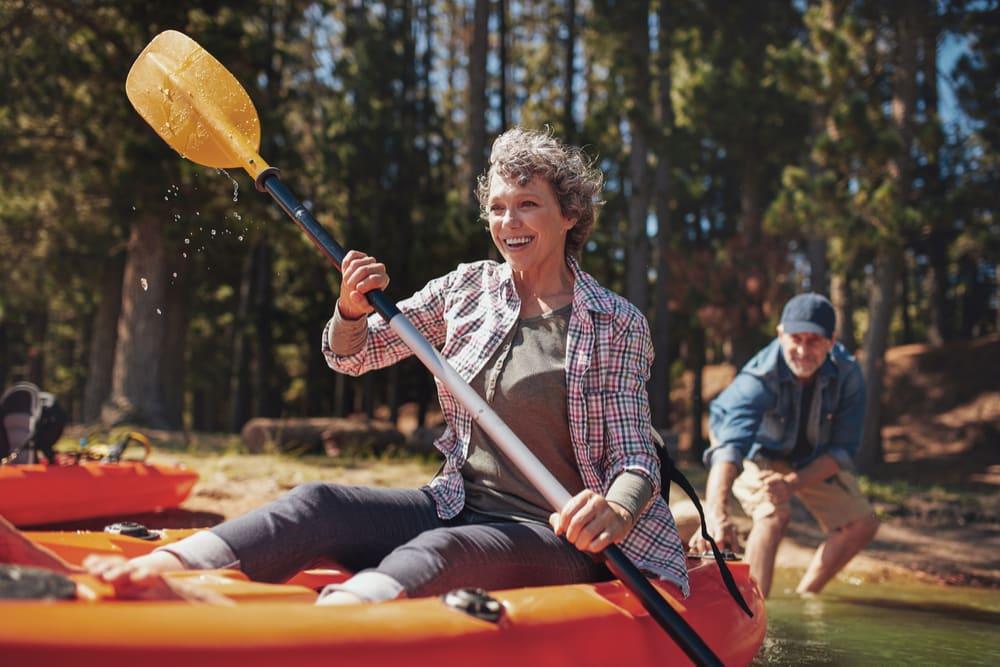 senior woman canoeing