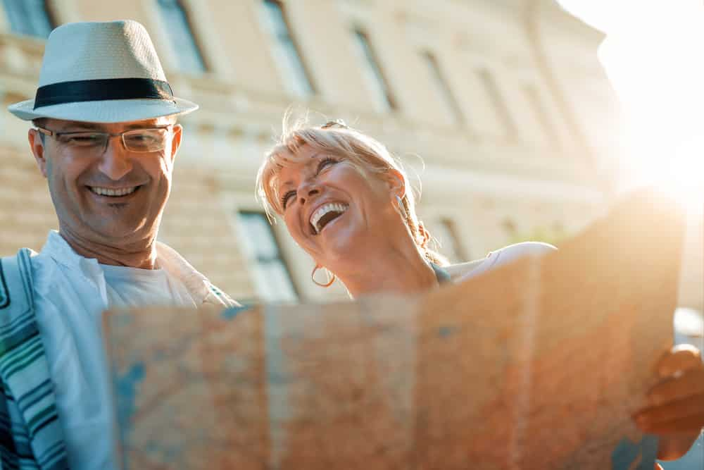 How Long After Hip Replacement Can I Fly? Middle age couple reading a map in the sun
