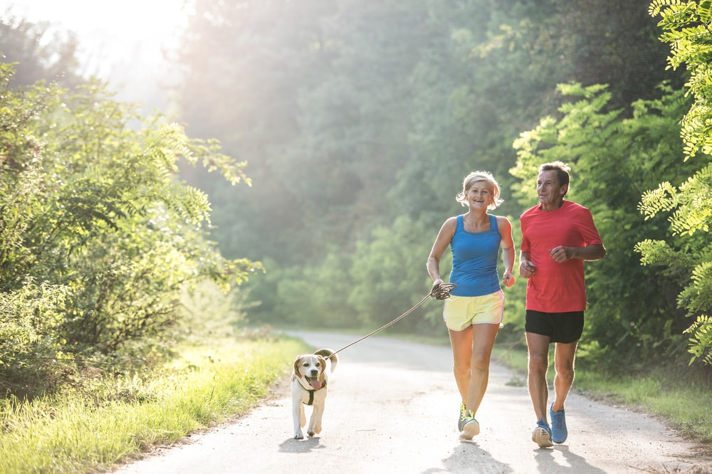 10 things people with diabetes want you to know: Senior couple running with dog