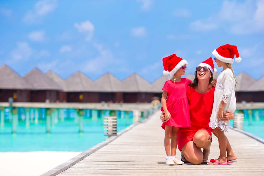 The best reasons to holiday abroad at Christmas: Mother and daughters on Christmas holiday by the sea