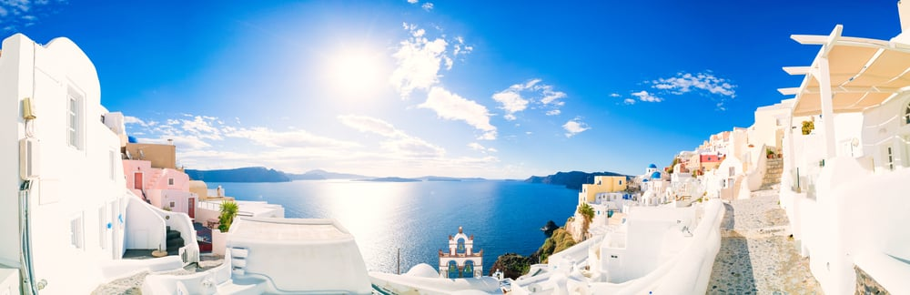 5 important questions to ask about your travel insurance: Santorini skyline in the sunshine
