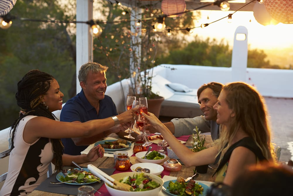 10 things that make a great British holiday: a group of friends drinking round a table