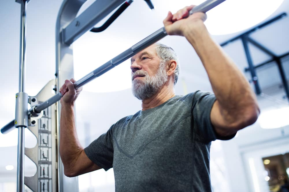 How to get fit when you are over 50 | Be inspired by this summer of sport: Old man lifting weights