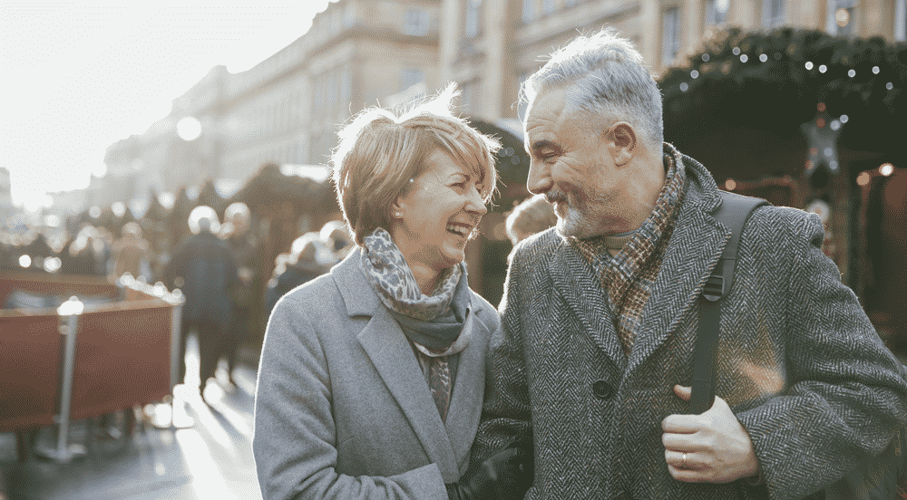 10 of the best Christmas markets in Europe: Mature couple laughing at Christmas market