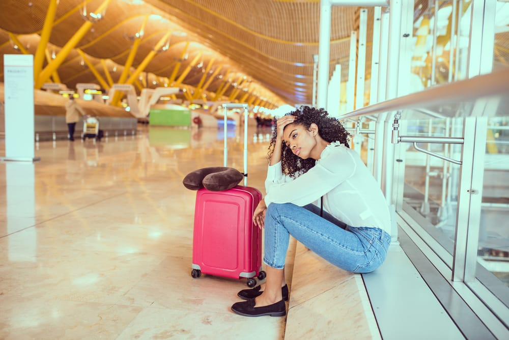 Lady in airport disappointed because of financial failure of airline