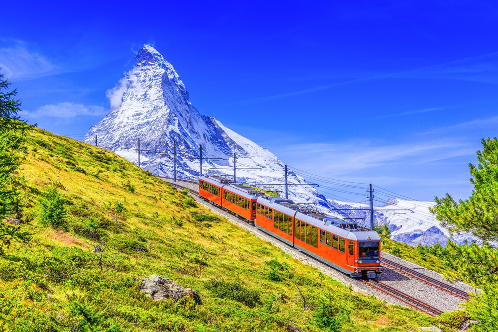Top 5 travel destinations for spring 2019: Gornergrat tourist train in front of Matterhorn mountain, Zermatt, Switzerland