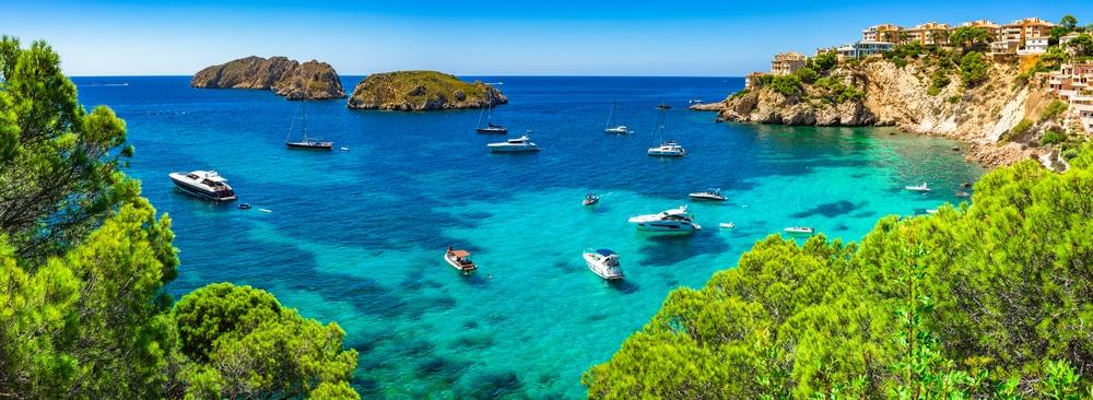 Palma de Mallorca – The ideal city break: panoramic view of boats in the sea in mallorca