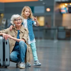 How Long After Hip Replacement Can I Fly? Grandmother at the airport with her granddaughter