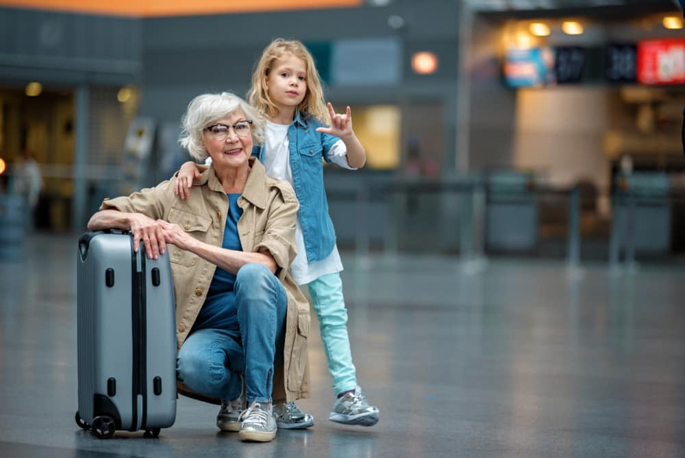 Flying with High Blood Pressure: Grandmother and grandaughter having fun at airport