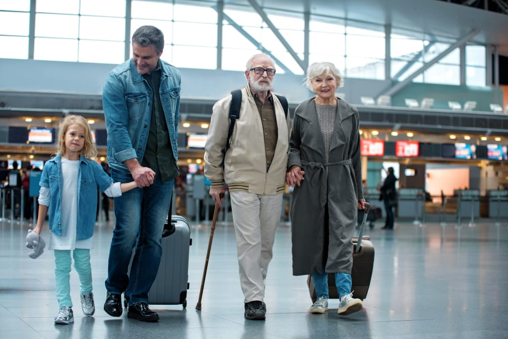 Travelling With A Disability - Disabled Holiday Ideas & Tips: Grandparents with family at the airport