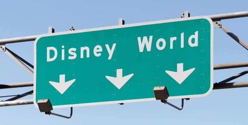 A sign for Disney World following single trip travel insurance to America